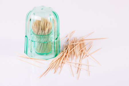 Wooden toothpicks on white background isolate