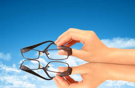 Photo pour Glasses against blue sky - image libre de droit