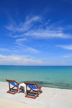 chairs on  the white sand b
