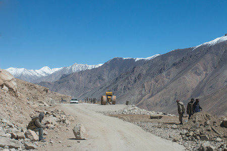 KASHMIR, INDIA - SEPTEMBER 17: Unidentified road builders on Zoji La, Srinagar - Leh road, India, September 17, 2014. Zoji La is a Himalayan pass at elevation of 3,528 m. It's the most dangerous pass in Kashmir