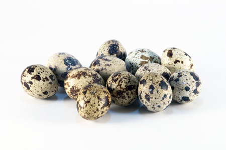Group of quail eggs on a white background