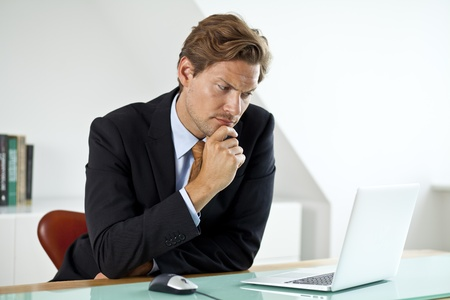 Concerned Businessman Wondering about something
