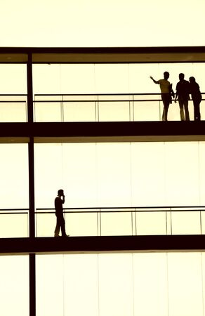 people inside the modern building in silhouette