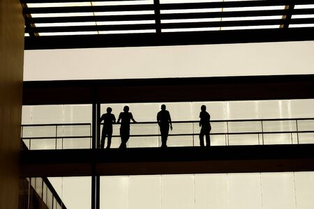 people inside the modern building, students in silhouette