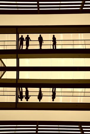 workers inside the modern building in silhouette