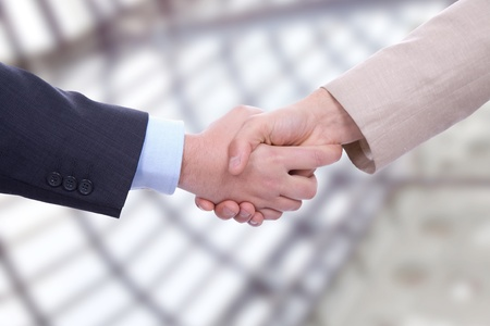 Photo for Business men in a handshake at the office - Royalty Free Image
