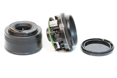 DSLR camera lenses that are worn on a white background.