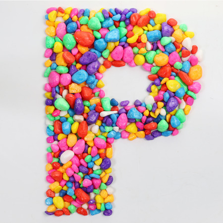 Colored stones arranged in a letter P.