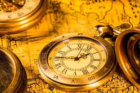 Photo pour Vintage compass and pocket watch. Map of the Ancient World in 1565. - image libre de droit