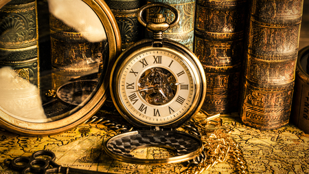 Foto für Antique clock on the background of a magnifying glass and books. Vintage style. 1565 old map of the year. - Lizenzfreies Bild