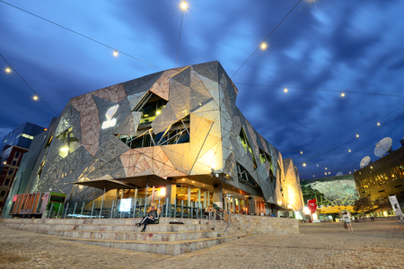 MELBOURNE, AUSTRALIA - OCTOBER 25, 2015: Night view of the Federation square in Melbourne, Australia. Federation Square is a mixed-use development in the inner city of Melbourne.