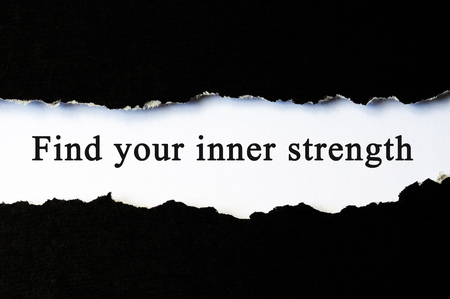 Find your inner strength concept phrase under torn paper