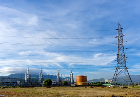 Power plant, energy power station and electric pylon, high-voltage electric tower against blue sky