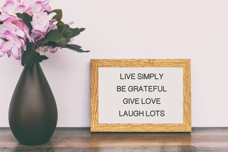 Photo for Inspirational Quotes - Live simply, be grateful, give love, laugh lots. - Royalty Free Image