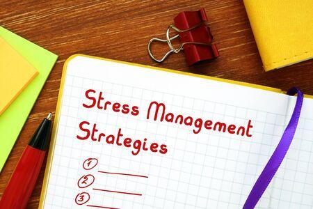 Foto de Motivation concept meaning Stress Management Strategies with sign on the sheet. - Imagen libre de derechos