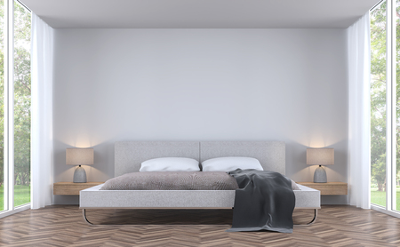 Modern styles bedroom with garden view 3d rendering image.There are white wall and wooden floor finished with fabric bed.There are large window overlooking the surrounding garden and nature