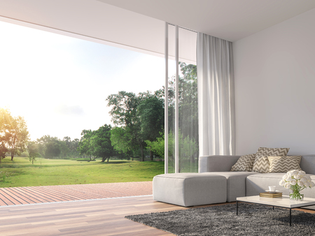 Photo pour Modern living room 3d render.The Rooms have wooden floors ,decorate with white fabric  sofa,There are large open sliding doors, Overlooks wooden terrace and big garden. - image libre de droit