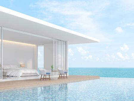Photo pour A white villa in minimal style with a sliding open overlooking the bedroom. In front of the bedroom is a wooden balcony and swimming pool. That overlooks the sea - 3d render - image libre de droit