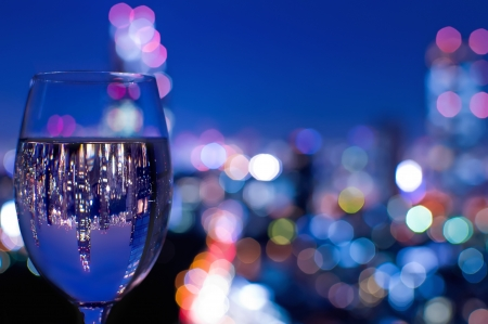 Tokyo skyline reflected in a wine glass