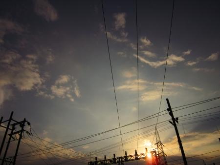 electrical mast, pole, transmission line during sunset