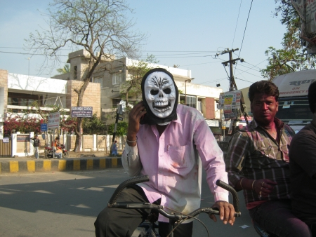 UNIDENTIFIED PEOPLE WEARS MASK AT HOLI, FESTIVAL OF COLOR. SHOT AT AFTERNOON HOURS ON MARCH 27, 2013 IN PATNA, BIHAR, INDIA.
