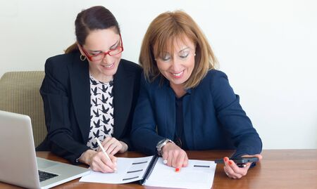 Photo for Portrait of two happy and successful mature business women working together. - Royalty Free Image