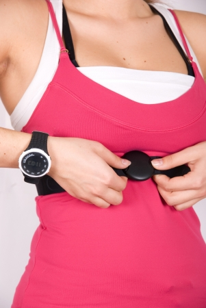 Girl with checking pulse watch closeup