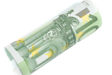 Roll of one hundred euro banknotes on the white background