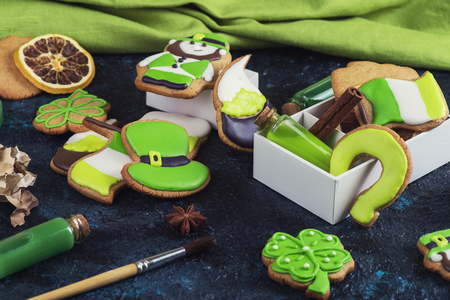 Homemade cookies for Patricks day on dark concrete background