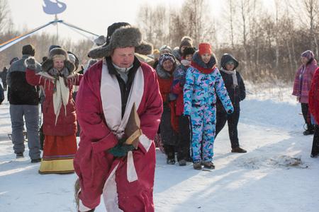 SVETLOE LAKE. ALTAISKIY KRAI. WESTERN SIBERIA. RUSSIA - DECEMBER 2, 2018: Folk winter games (running race with broom) in the Altaiskaya Zimovka holiday - the first day of winter on December 2, 2018 in Altayskiy krai, Siberia, Russia.