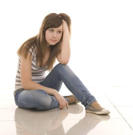 sad teenager over white