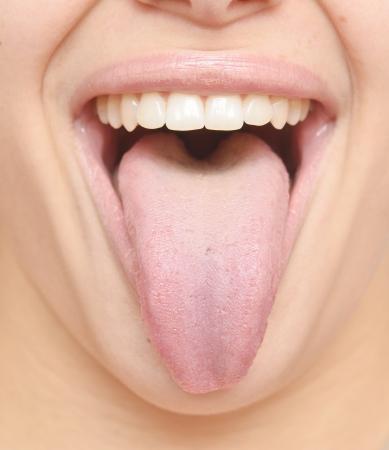 Photo pour close up of healthy woman tongue - image libre de droit