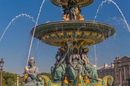 Photo pour Beautiful working fountains in the center of Paris in France with different statues on a hot day - image libre de droit