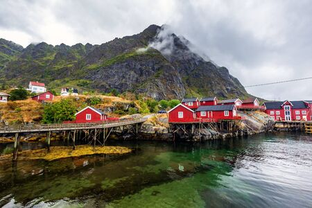 """Red houses at Å (meaning """"stream"""") is a village in Moskenes Municipality in Nordland county, Norway. This is last town on Lofoten islands by highway called King Olav's Road.の素材 [FY310138524122]"""