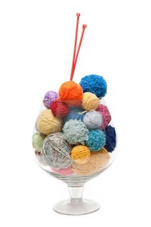 Glass with ball of the threads and spokes for knitting