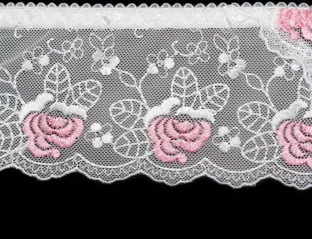 Lace decorated by pattern and decorative rose on black background