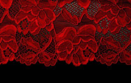 Photo pour Red lace insulated on black background - image libre de droit
