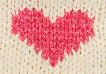 knit red heart of the warm woolen threads
