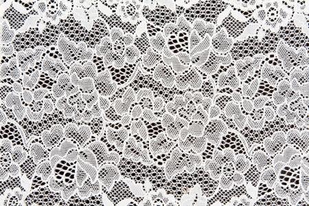 Photo pour White lace in the background on a dark - image libre de droit