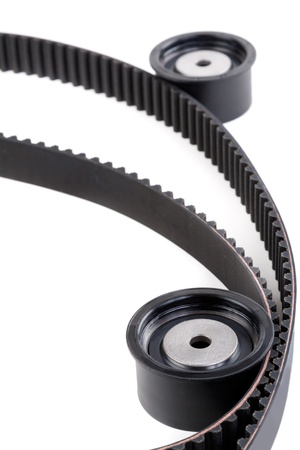 Roller and timing belt isolated on white