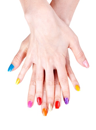 Women's hands with a colored nail polish (manicure). Isolate on white