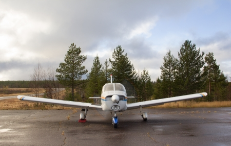 small aircraft parking stands at the airfield in the forest ready to go. Front view.