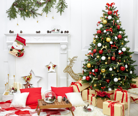 Foto per Christmas tree in the room near the fireplace, the Christmas mood with gifts - Immagine Royalty Free