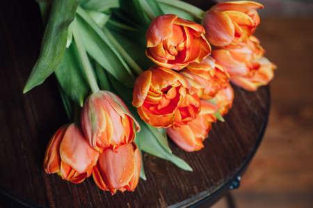 Photo pour orange Dutch tulips over wooden table background - image libre de droit