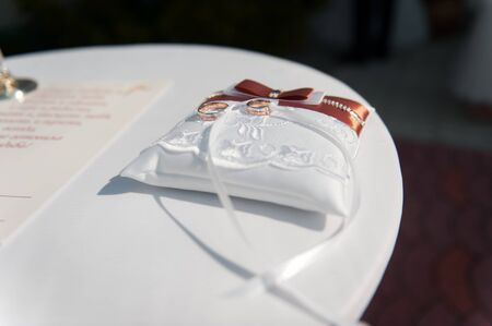 pair of  wedding rings with bokeh background paper