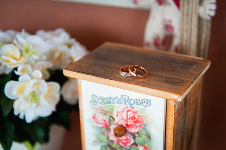 wedding rings on a dense fabric of the chair with bokeh background