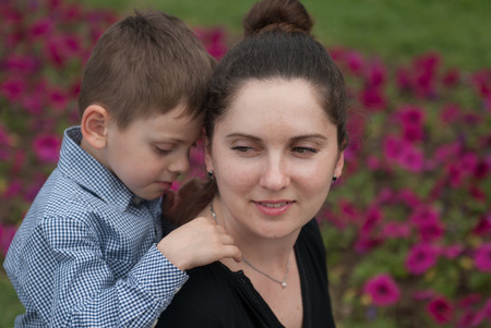 portrait of smiling mother and her cute little son