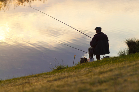 Photo pour Fisherman fishing. A fisherman catches a fish in the morning - image libre de droit