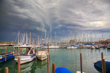Photo pour yachts in Venice , clouds over harbor - image libre de droit