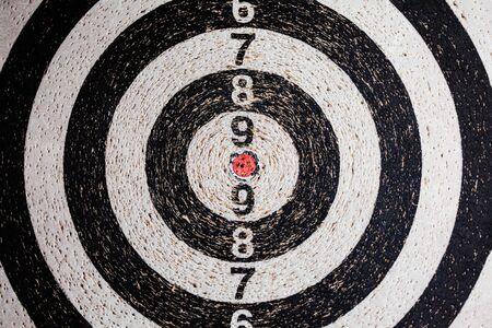 Photo pour Dart board with numerous punctures . Black and white dart's target - image libre de droit